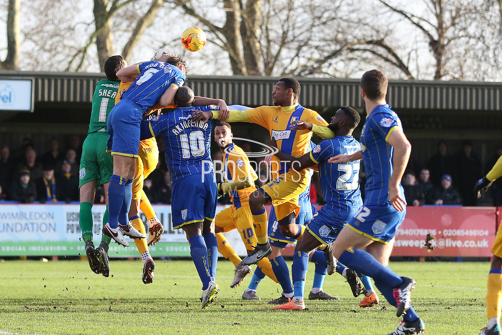 James Shea (Goalkeeper) of AFC Wimbledon gets the punch during the Sky Bet League 2 match between AFC Wimbledon and Mansfield Town at the Cherry Red Records Stadium, Kingston, England on 16 January 2016. Photo by Stuart Butcher.
