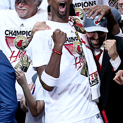 Jun 21, 2012; Miami, FL, USA; Miami Heat power forward Chris Bosh (1) celebrates after winning the NBA championship in game five of the 2012 NBA Finals against the Oklahoma City Thunder at the American Airlines Arena. Miami won 121-106. Mandatory Credit: Derick E. Hingle-US PRESSWIRE