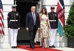 U.S. President Donald Trump and First Lady Melania Trump arrive to welcome Kenya's President Uhuru Kenyatta and Mrs. Margaret Kenyatta to the White House August 27, 2018 in Washington, DC. . Photo by Olivier Douliery/ Abaca Press