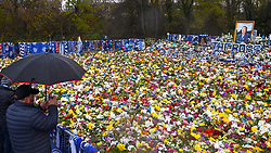 """Fans view floral tributes for those who lost their lives in the Leicester City helicopter crach including Leicester City Chairman Vichai Srivaddhanaprabha ahead of the Premier League match at the King Power Stadium, Leicester. PRESS ASSOCIATION Photo. Picture date: Saturday November 10, 2018. See PA story SOCCER Leicester. Photo credit should read: Joe Giddens/PA Wire. RESTRICTIONS: EDITORIAL USE ONLY No use with unauthorised audio, video, data, fixture lists, club/league logos or """"live"""" services. Online in-match use limited to 120 images, no video emulation. No use in betting, games or single club/league/player publications."""