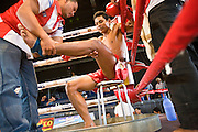 02 JULY 2006 - PHNOM PENH, CAMBODIA: Between rounds during a traditional Khmer boxing match in Phnom Penh, Cambodia. Khmer boxing is the same sport as Muay Thai (traditional Thai kick boxing) but because off animosity between Thailand and Cambodia it is called Khmer Boxing in Cambodia. The Cambodians claim to have invented the sport, which is also practiced in Laos and Burma. Photo by Jack Kurtz