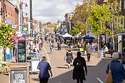 Shops and shoppers in pedestrianised Northbrook Street, Newbury, Berkshire, England, UK