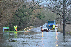 © Licensed to London News Pictures. 03/01/2014. Jacobs Well, UK Many cars turned around. Cars pass through flood water created by the River Mole bursting it's banks at Jacobs Well in Surrey today 3rd January 2013. Floods an heavy rain are continuing to effect travel and people across the country today. Photo credit : Stephen Simpson/LNP