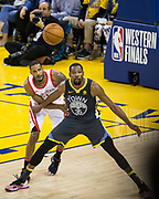 Golden State Warriors forward Kevin Durant (35) posts up Houston Rockets forward Trevor Ariza (1) during Game 4 of the Western Conference Finals at Oracle Arena in Oakland, Calif., on May 22, 2018. (Stan Olszewski/Special to S.F. Examiner)