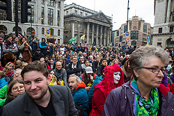 London, UK. 14 October, 2019. Climate activists from Extinction Rebellion watch theatrical mock trials, of the UK's financial sector for the crime of ecocide and of the Government for 'criminal negligence' in having permitted it, in front of the Bank of England. Roads were blocked around Bank on the eighth day of International Rebellion protests across London.