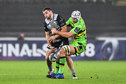 Ospreys' Nicky Smith is tackled by Northampton Saints' Michael Paterson<br /> <br /> Photographer Craig Thomas/Replay Images<br /> <br /> EPCR Champions Cup Round 4 - Ospreys v Northampton Saints - Sunday 17th December 2017 - Parc y Scarlets - Llanelli<br /> <br /> World Copyright © 2017 Replay Images. All rights reserved. info@replayimages.co.uk - www.replayimages.co.uk