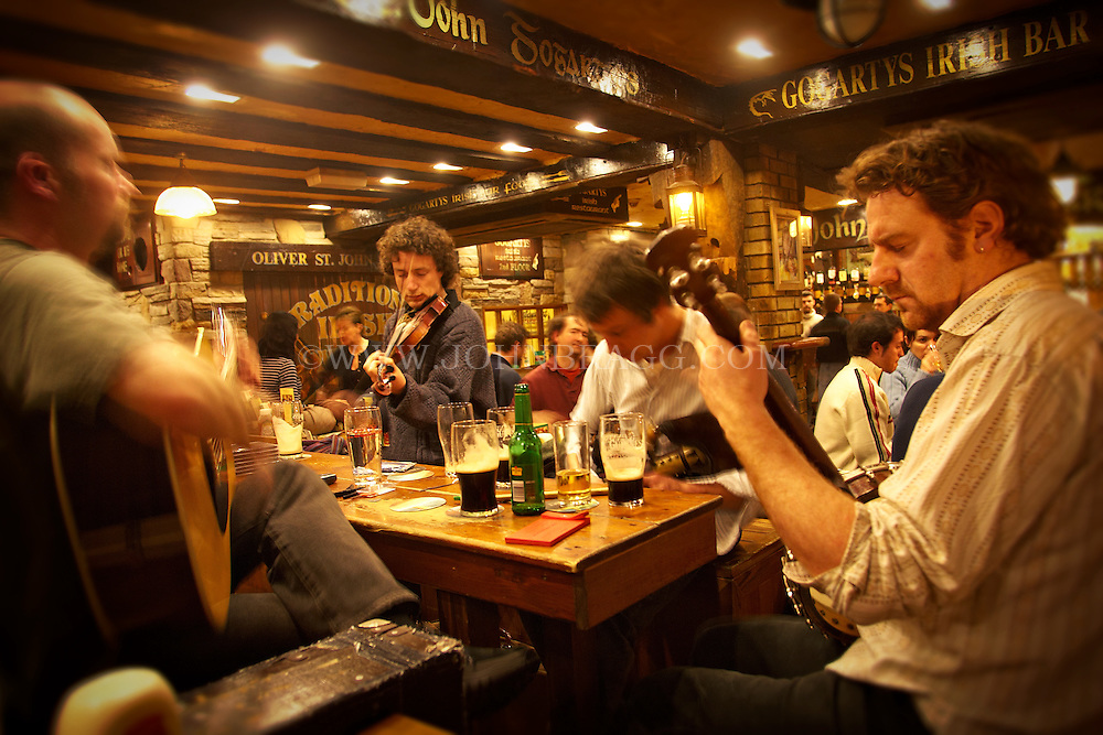A traditional Irish band playing from inside Gogarty's Irish Bar in Dublin, Ireland