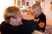 Dad and son having a good laugh age 32 and 3. Balucki District Lodz Central Poland