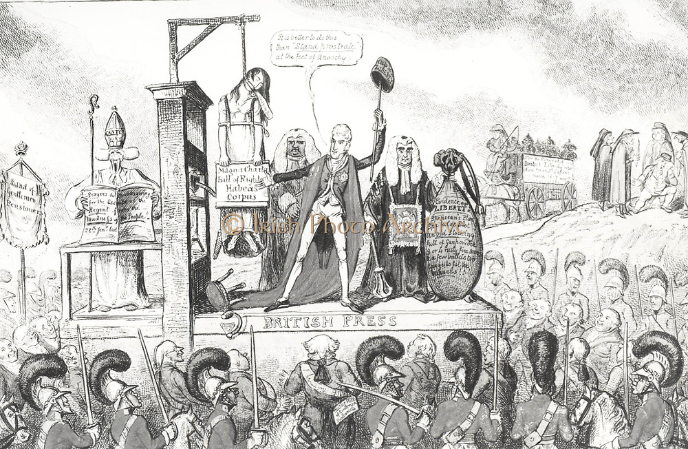 Liberty Suspended!' Lord Castlereagh and Lord Eldon stand at the foot of the scaffold on which the liberty of the British Press is being suspended. Archbishop of Canterbury reads prayers  preserving the Regent from the madness of the people.. Top right, the body of Liberty is being driven to the grave. 1817 cartoon on censorship.