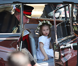 Princess Charlotte and the Duke of Cambridge leave St George's Chapel in Windsor Castle after the wedding of Prince Harry and Meghan Markle.