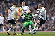 Alberto Paloschi of Swansea City © finds himself closely  marked by Toby Alderweireld of Tottenham Hotspur and Kevin Wimmer of Tottenham Hotspur. Barclays Premier league match, Tottenham Hotspur v Swansea city at White Hart Lane in London on Sunday 28th February 2016.<br /> pic by John Patrick Fletcher, Andrew Orchard sports photography.