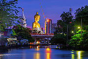 A new Buddha appears on the Bangkok skyline. The statue, called 'Dhammakaya Thep Mongkol Buddha' at Paknam Bhasicharoen Temple, is made of copper, and corresponds with the image the former abbot saw in his dream.