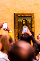 Mona LIsa (in Italian: La Gioconda) by Italian Renaissance artist Leonardo da Vinci mobbed by smart phone toting selfie takers, Louvre Museum, Paris, France. Soon after this photo was taken the Louvre employees went on strike because of the extreme crowds surrounded the painting.