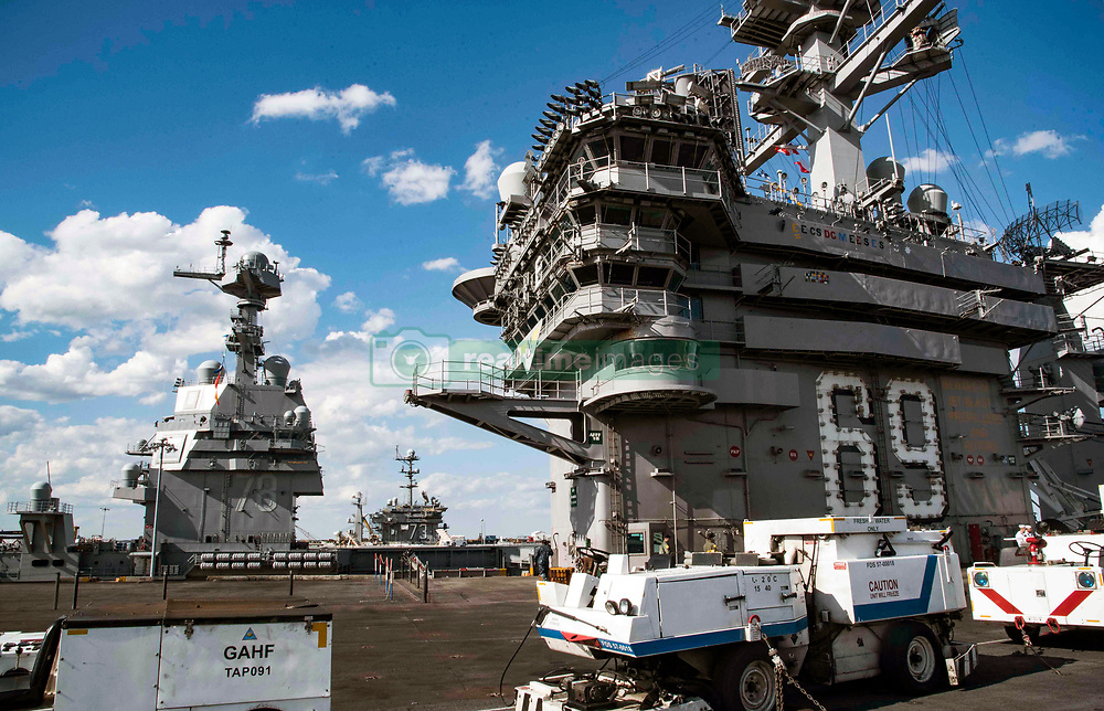 NORFOLK (May 8, 2017) The aircraft carriers USS Dwight D. Eisenhower (CVN 69), pre-commissioning unit aircraft carrier Gerald R. Ford (CVN 78) and USS George Washington (CVN 73) sit pierside at Naval Station Norfolk. (U.S. Navy photo by Mass Communication Specialist 3rd Class Dartez C. Williams/Released)170508-N-QN175-178<br />Join the conversation:<br />http://www.navy.mil/viewGallery.asp<br />http://www.facebook.com/USNavy<br />http://www.twitter.com/USNavy<br />http://navylive.dodlive.mil<br />http://pinterest.com<br />https://plus.google.com