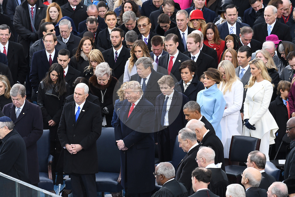 President Donald Trump and Vice President Mike Pence stand for a prayer after taking the oath of office as the 45th President during the Inaugural Ceremony on Capitol Hill January 20, 2017 in Washington, DC.
