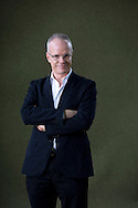 Swiss-born art historian, critic and curator Hans-Ulrich Obrist, pictured at the Edinburgh International Book Festival where he talked about his book entitled 'Ways of Curating'. The three-week event is the world's biggest literary festival and is held during the annual Edinburgh Festival. The 2014 event featured talks and presentations by more than 500 authors from around the world and was the 31st edition of the festival.