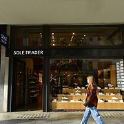 UK PM Boris Johnson announces closure of pub, bars and restaurants to fight Coronavirus - Pandemic hit Oxford Street many shops closure a few open but empty on 21 March 2020, UK.