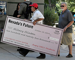 Oct. 19, 2016 - Las Vegas, Nevada, U.S. - A protesters carries a check at the rally at UNLV hours before the debate Wednesday. Hillary Clinton was previously paid $225,000 to address a  fundraiser for the University of Nevada. The fee sparked an outcry.  (Credit Image: © Gene Blevins via ZUMA Wire)