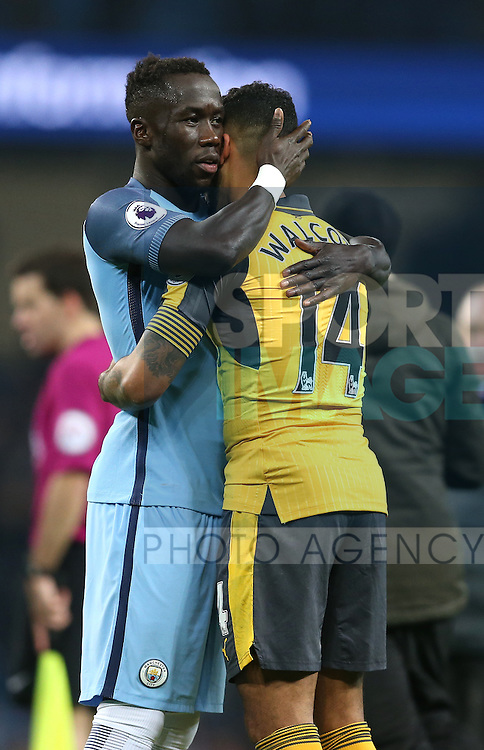 Bacary Sagna of Manchester City commiserates with Theo Walcott of Arsenal during the English Premier League match at the Etihad Stadium, Manchester. Picture date: December 18th, 2016. Picture credit should read: Simon Bellis/Sportimage