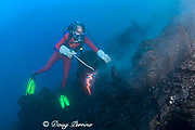 shimmering heat waves distort the image of diver Bud Turpin as he samples erupting pillow lava at ocean entry of Kilauea Volcano Hawaii Island ( the Big Island ) Hawaii U.S.A. ( Central Pacific Ocean ) MR 381