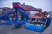 A08APB Family in Twister fun fair ride