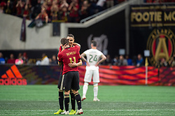 December 8, 2018 - Atlanta, Georgia, United States - Atlanta United midfielder ERIC REMEDI (11) hugs Atlanta United midfielder MIGUEL ALMIRON (10) as he walks off the field during the MLS Cup at Mercedes-Benz Stadium in Atlanta, Georgia.  Atlanta United defeats Portland Timbers 2-0 (Credit Image: © Mark Smith/ZUMA Wire)
