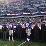Giants players and first response representatives hold a giant USA flag after Hurricane Sandy devastated New Jersey before the New York Giants V Pittsburgh Steelers NFL American Football match at MetLife Stadium, East Rutherford, NJ, USA. 4th November 2012. Photo Tim Clayton