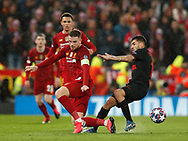 Jordan Henderson of Liverpool fouls Angel Correa of Atletico Madrid  during the UEFA Champions League match at Anfield, Liverpool. Picture date: 11th March 2020. Picture credit should read: Darren Staples/Sportimage