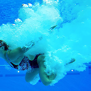 Cassidy Krug of the United States rose to the water's surface after her dive in the women's 3m springboard preliminaries at the Aquatics Centre in Olympic Park during the 2012 Summer Olympic Games in London, England, Friday, August 3, 2012. (David Eulitt/Kansas City Star/MCT)