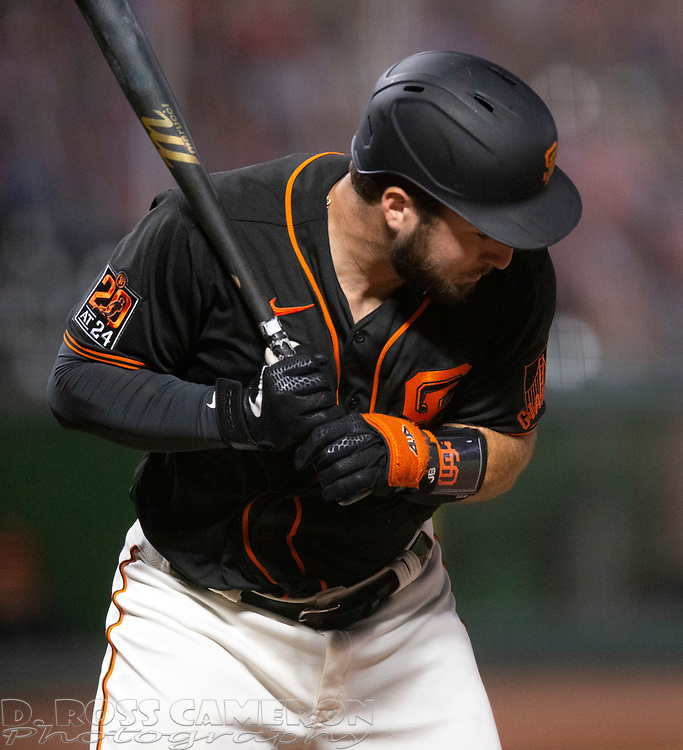 Aug 22, 2020; San Francisco, California, USA; San Francisco Giants Joey Bart is hit by a pitch during the eighth inning of a baseball game against the Arizona Diamondbacks at Oracle Park. Mandatory Credit: D. Ross Cameron-USA TODAY Sports