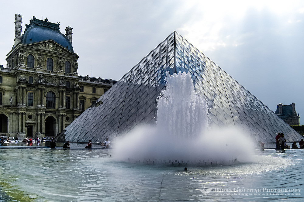 The Louvre Pyramid serves as the main entrance to the Louvre Museum in Paris, France.