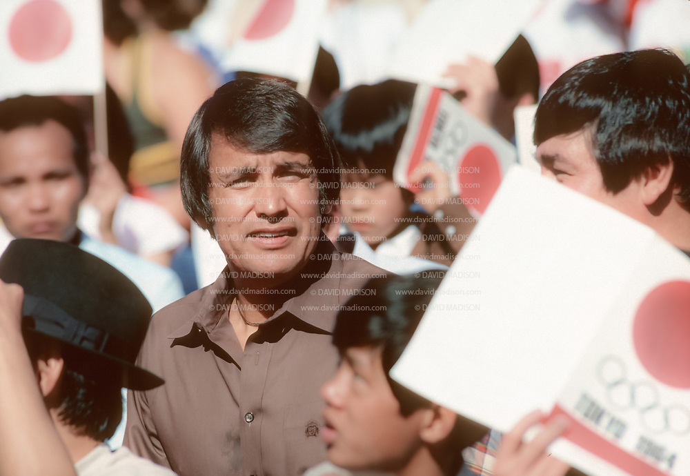 EDMONTON, CANADA - OCTOBER 11:  Billy Mills of the USA sits among crowd extras during the filming of the movie Running Brave in Commonwealth Stadium in Edmonton, Canada on October 11, 1982.  The movie recreates Mills' historic win in the 1964 Olympic Games 10000 meter race.  (Photo by David Madison/Getty Images)
