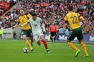 Dele Alli of England battles for possession with Arturas Zulpa of Lithuania during the FIFA World Cup Qualifier group stage match between England and Lithuania at Wembley Stadium, London, England on 26 March 2017. Photo by Matthew Redman.