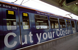 Metro train decorated with banner ad Cut your CO2 day; campaign to make Newcastle carbon neutral city, UK Oct 2003