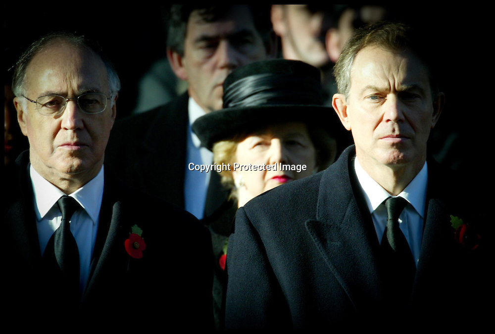 The British Prime Minister Tony Blair and The Leader of the conservative Party Michael Howard during the remembrance service at the cenotaph.PA Photo Andrew Parsons