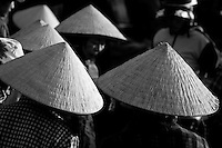 Women wearing conical hats in the Hoi An fish market.