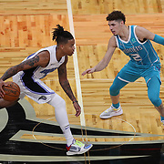 ORLANDO, FL - DECEMBER 17:  Markelle Fultz #20 of the Orlando Magic drives the ball against LaMelo Ball #2 of the Charlotte Hornets at Amway Center on December 17, 2020 in Orlando, Florida. NOTE TO USER: User expressly acknowledges and agrees that, by downloading and or using this photograph, User is consenting to the terms and conditions of the Getty Images License Agreement. (Photo by Alex Menendez/Getty Images)