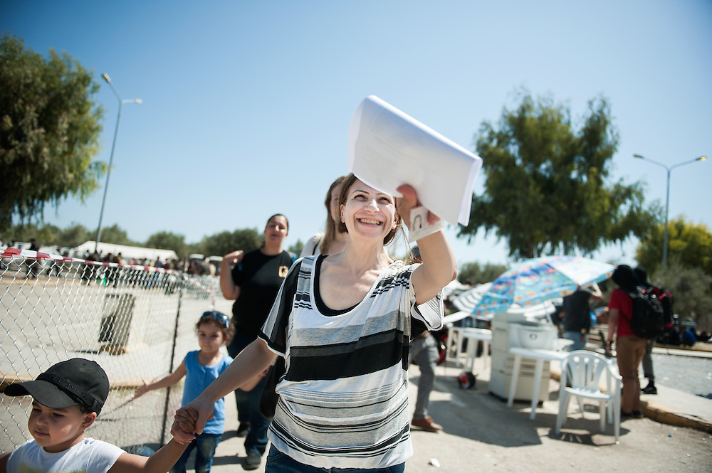 Afternoon, Friday 11th of September 2015. Aysha is holding a document from the Greek Police that allows her and her daughters to stay temporarily in Greece and travel from Lesbos island to mainland Greece. The registration process took her a couple of hours, there was priority for women with children.