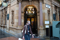 Glasgow, Scotland, UK. 20 November 2020. On the day when the severest level 4 lockdown will be imposed at 6pm, shoppers are out on the streets of Glasgow doing last minute Christmas shopping before the shops close for 3 weeks. Pictured; The Ivy restaurant will close today.   Iain Masterton/Alamy Live News