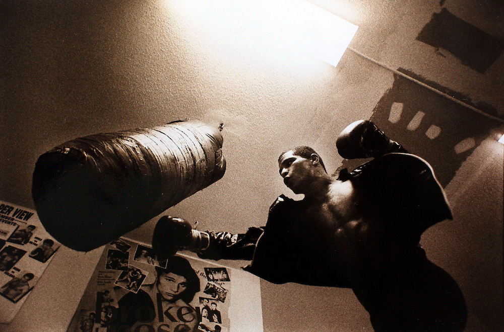 A boxer works out with a punching bag