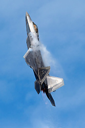 An F-22 Raptor piloted by a member of the Air Combat Command F-22 Demonstration Team performs aerial maneuvers during the Arctic Thunder Open House at Joint Base Elmendorf-Richardson, Alaska, June 30, 2018. This biennial event is one of the largest in the state and one of the premier aerial demonstrations in the world. The event featured multiple performers and ground acts to include the JB Elmendorf-Richardson joint forces, U.S. Air Force F-22 and U.S. Air Force Thunderbirds demonstrations teams, June 30-July 1. (U.S. Air Force photo by Alejandro Peña)