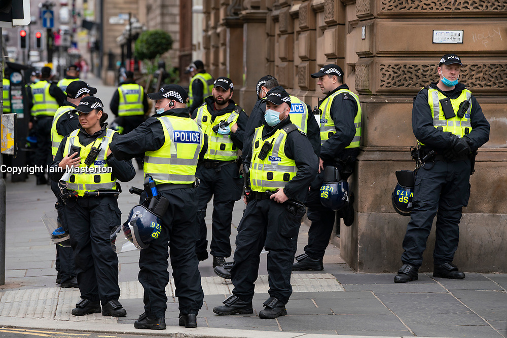 Glasgow, Scotland, UK. 27 June, 2020. Heavy police presence in George Square ahead of potential demonstrations by left and right wing groups.   Iain Masterton/Alamy Live News