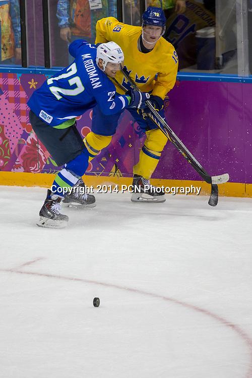 Marcel Rodman (SLO)-22, Marcel Rodman (SWE)-19 during Sweden vs Slovenia game at the Olympic Winter Games, Sochi 2014