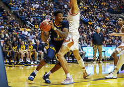 Feb 9, 2019; Morgantown, WV, USA; West Virginia Mountaineers forward Derek Culver (1) looks to pass under the basket during the second half against the Texas Longhorns at WVU Coliseum. Mandatory Credit: Ben Queen-USA TODAY Sports