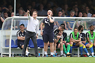 AFC Wimbledon manager Neal Ardley and AFC Wimbledon assistant coach Neil Cox shouting instructions during the EFL Sky Bet League 1 match between AFC Wimbledon and Oldham Athletic at the Cherry Red Records Stadium, Kingston, England on 21 April 2018. Picture by Matthew Redman.