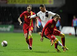 Marko Arnautovic (Werder Bremen) of Austria  battles for the ball with Chris Gunter (Reading) of Wales  - Photo mandatory by-line: Joe Meredith/JMP - Tel: Mobile: 07966 386802 06/02/2013 - SPORT - FOOTBALL - Liberty Stadium - Swansea  -  Wales V Austria - International Friendly