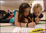 May 15, 2013 Roswell: First graders Callie Beekman ,7, and Mary Hayes,7, complete and assignment  at Northwood Elementary School on Wednesday, May 15, 2013.  Northwood Elementary failed to meet adequate yearly progress under No Child Left Behind, but it got a 96.6 CCRPI grade, highlighting stark differences between the two measuring systems. © 2013 JOHNNY CRAWFORD