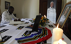 HARARE, Dec. 11, 2013  A Zimbabwean man signs the book of condolence for the former South African President Nelson Mandela during a memorial held at the South African Embassy in Harare, capital of Zimbabwe, Dec. 11, 2013. As its north neighbor, Zimbabwe enjoys close ties both politically and economically with South Africa. (Credit Image: © Stringer/Xinhua/ZUMAPRESS.com)
