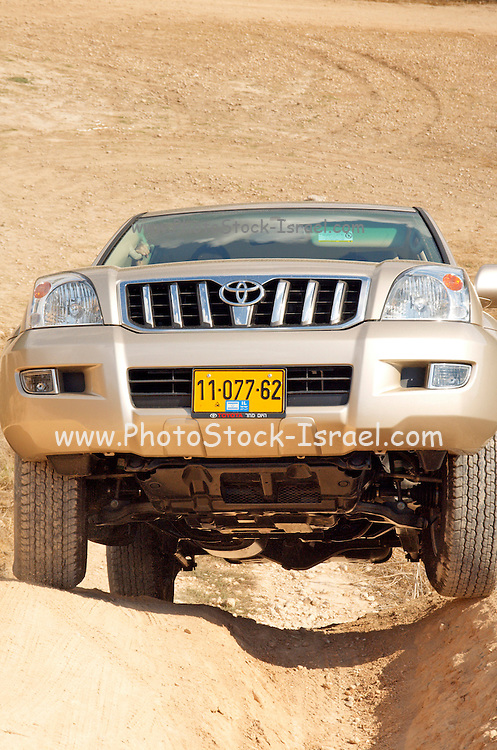 Toyota landcruiser, negotiating a steep dirt road hill, October 2006