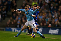 MANCHESTER, ENGLAND - Monday, February 25, 2008: Everton's Tim Cahill and Manchester City's Dietmar Hamann during the Premiership match at the City of Manchester Stadium. (Photo by David Rawcliffe/Propaganda)